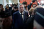 Mayor of Levallois-Perret Patrick Balkany is surrounded by journalists as he arrives for his trial at the Paris courthouse, France, May 13, 2019. Picture taken May 13, 2019. REUTERS/Benoit Tessier