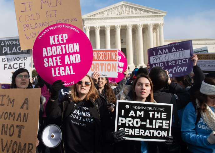 Pro-and anti-abortion activists gathered in Supreme Court, January 18.