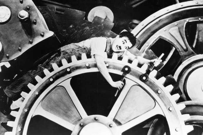 Charlie Chaplin à l'épreuve dans « Les temps modernes», en 1936. Depuis, l'économie a évolué, mais le travail ?