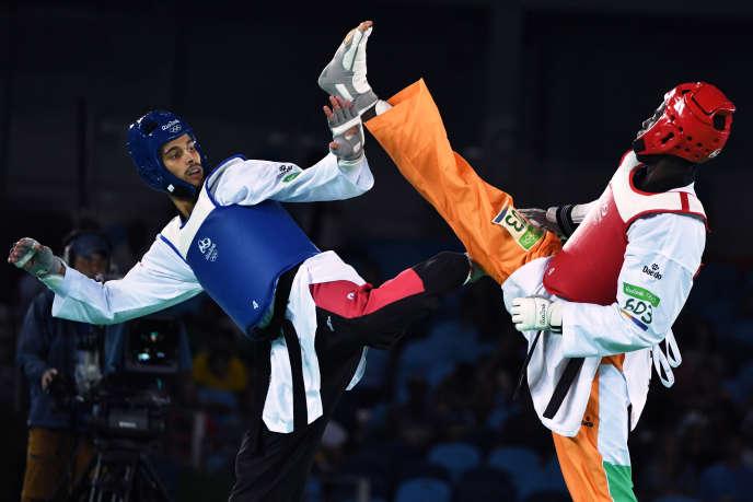 L'Ivoirien Cheick Cissé (ici à droite face au Tunisien Oussama Oueslati) a été sacré champion olympique de taekwondo dans la catégorie des moins de 80 kglors des JO de 2016 à Rio de Janeiro.