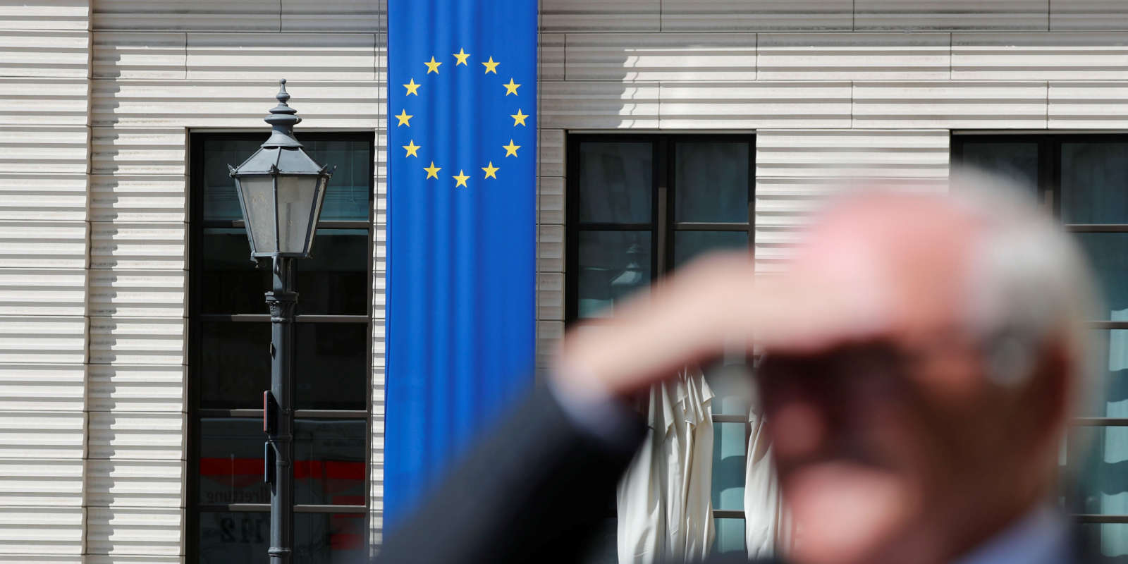 A man is seen beside an European Union flag ahead the upcoming EU Elections, at the European Parliament near the Brandenburg Gate in Berlin, Germany, May 21, 2019. REUTERS/Fabrizio Bensch