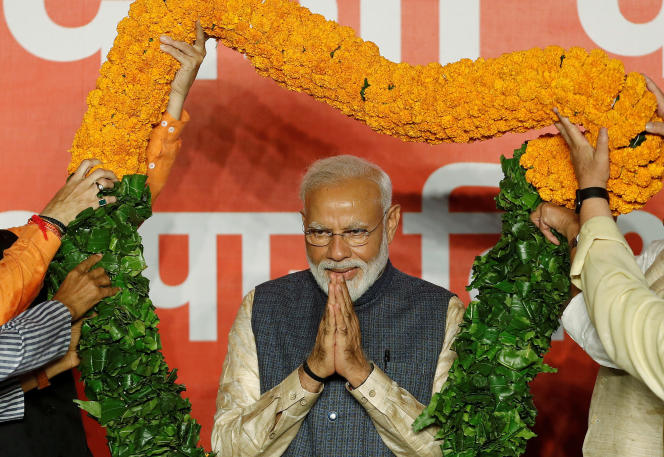 Le premier ministre Narendra Modi célèbre sa victoire aux élections législatives, à New Delhi, le 23 mai.