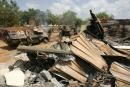 This general view shows French soldiers cleaning debris, 10 November 2004 at a bombed building they used at the Descartes lycee in Bouake. Nine French peacekeepers and a US civilian were killed 04 November 2004 when government SU-25 jets bombed a French military camp in Bouake in the course of what the government said were air strikes on rebel positions. AFP PHOTO PHILIPPE DESMAZES (Photo by PHILIPPE DESMAZES / AFP)