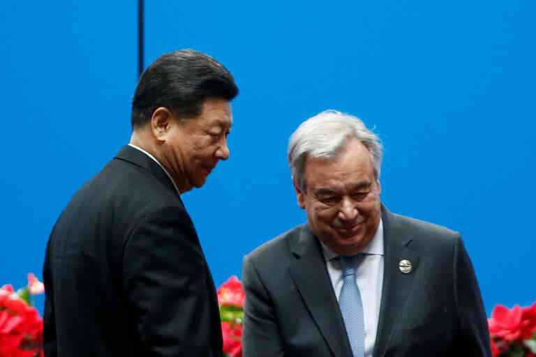 Secretary General of the United Nations Antonio Guterres returns to his seat after delivering a speech as Chinese President Xi Jinping stands next to him at the opening ceremony for the second Belt and Road Forum in Beijing, China April 26, 2019.  REUTERS/Florence Lo - RC1BBEB1B830