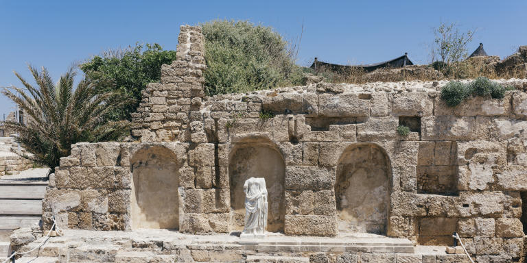 ISRAEL, Caesarea - A statue and a basin at the national park of Caesarea's Old Harbour on Wednesday, May 29, 2019. The Rothschild Caesarea Foundation was founded in the 1950s by Baron Edmond de Rothschild. Having acquired approximately 30,000 dunams in and around the ancient port city of Caesarea, the Rothschild family transferred this land to the Rothschild Caesarea Foundation and invited the State to partner the family in the legacy of the area. The Caesarea Rothschild Foundation manages the land assets in the vicinity of Caesarea and invests these profits in education and learning development in the country. Currently, the banker Baron Benjamin de Rothschild and his wife Baroness Ariane de Rothschild manage the Rothschild Caesarea Foundation's work in Israel and the Edmond de Rothschild Foundations' global network of arts, philanthropic, educational and social empowerment programs. (Jonas Opperskalski / laif)