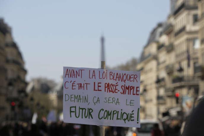Une pancate brandie lors d'une manifestation contre la loi Blanquer, à Paris, le 30 mars.