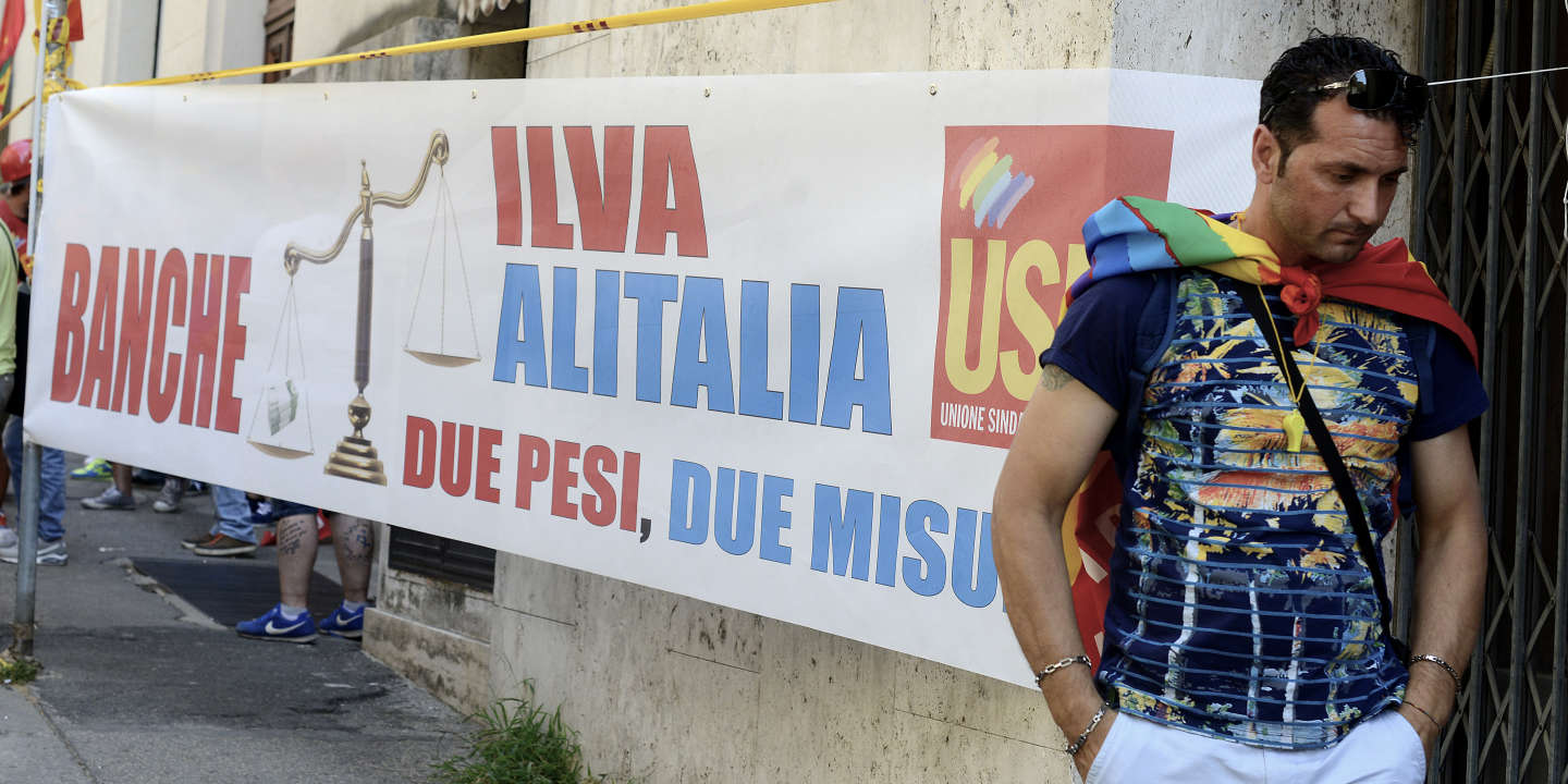 ROME, ITALY - JULY 20: Workers of ILVA steelworks protest at the Ministry of Economic Development against the sale of steel producer Ilva to ArcelorMittal, on July 20, 2017 in Rome, Italy.  (Photo by Simona Granati - Corbis/Corbis via Getty Images)