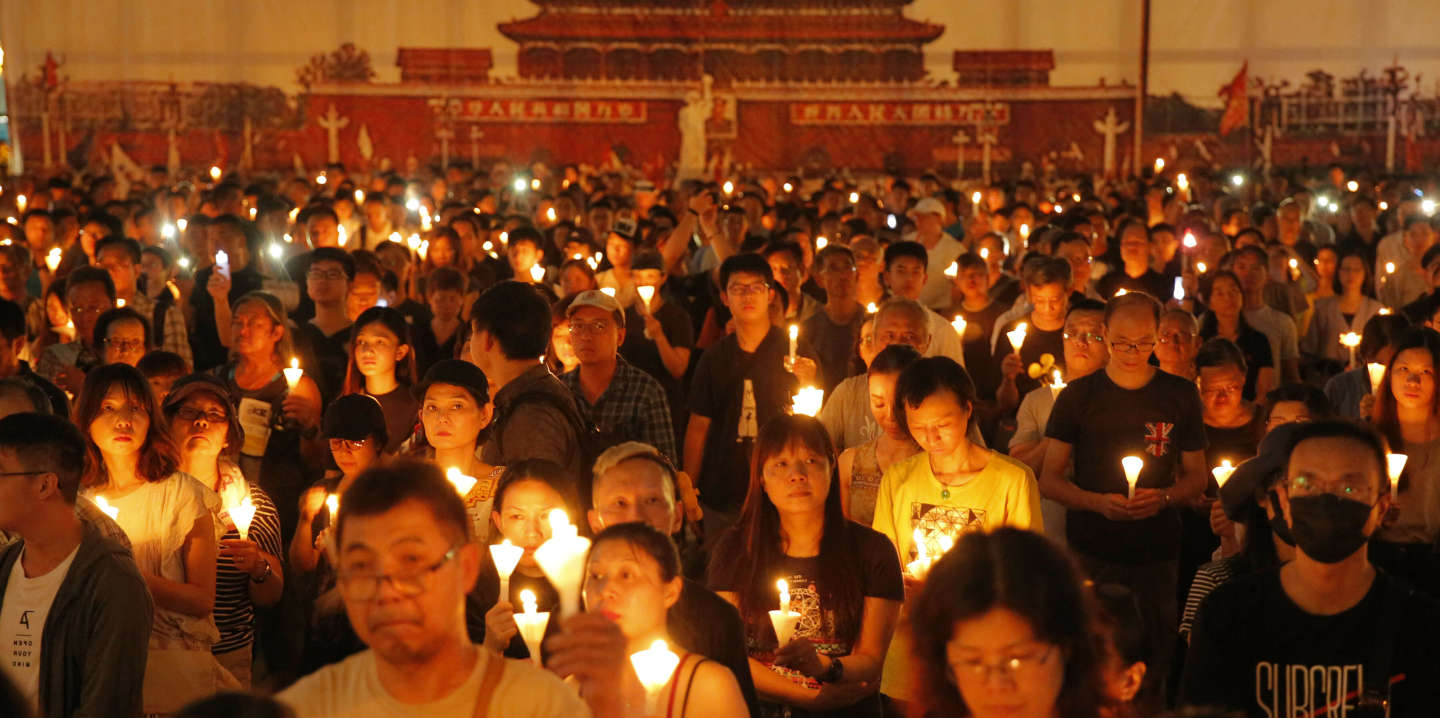 Thousands of people attend a candlelight vigil for victims of the Chinese government's brutal military crackdown three decades ago on protesters in Beijing's Tiananmen Square at Victoria Park in Hong Kong, Tuesday, June 4, 2019. Hong Kong is the only region under Beijing's jurisdiction that holds significant public commemorations of the 1989 crackdown and memorials for its victims. Hong Kong has a degree of freedom not seen on the mainland as a legacy of British rule that ended in 1997. (AP Photo/Kin Cheung)