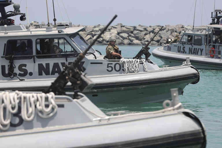 U.S. Navy patrol boats carrying journalists to see damaged oil tankers leaves a U.S. Navy 5th Fleet base near Fujairah, United Arab Emirates, Wednesday, June 19, 2019. The limpet mines used to attack a Japanese-owned oil tanker near the Strait of Hormuz bore