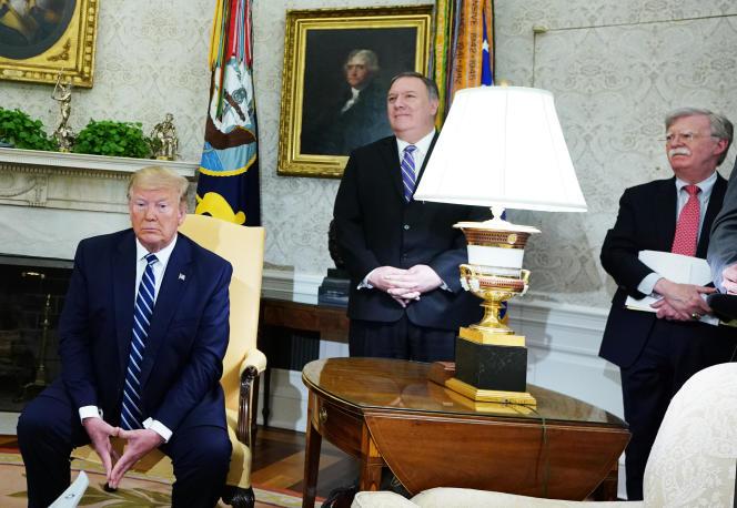 Donald Trump, son secrétaire d'Etat, Mike Pompeo, et son conseiller, John Bolton.
