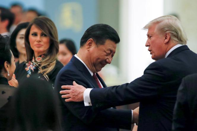 Le président chinois, Xi Jinping (gauche), et le président américain, Donald Trump (droite), lors d'une rencontre à Pékin, ennovembre2018.