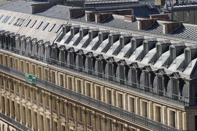 Façade d'un immeuble haussmannien, rue Scribe, dans le 9e arrondissement de Paris.