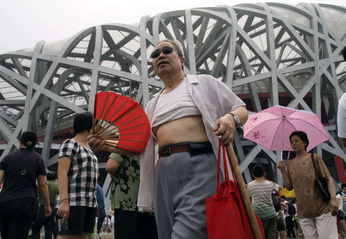 A man with a t-shirt raised the fate of the national stadium, Beijing, China, august 2009.