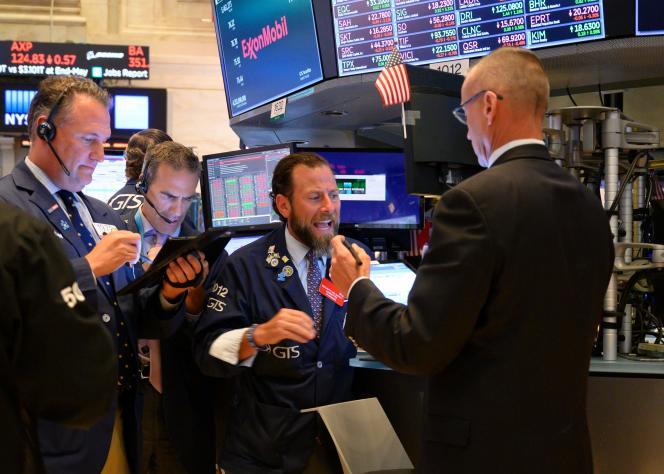 Des tradeurs à la Bourse de New York, le 8 juillet.
