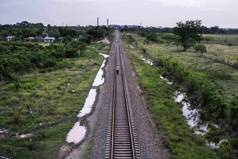 A man walks on the train tracks near the city of Camaguey.