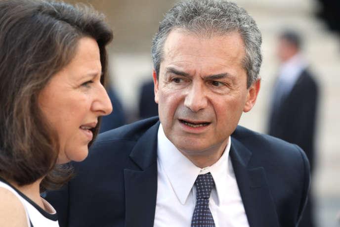 Le professeur Yves Lévy en compagnie de son épouse, la ministre de la santé Agnès Buzin, à Paris, en juillet 2018.
