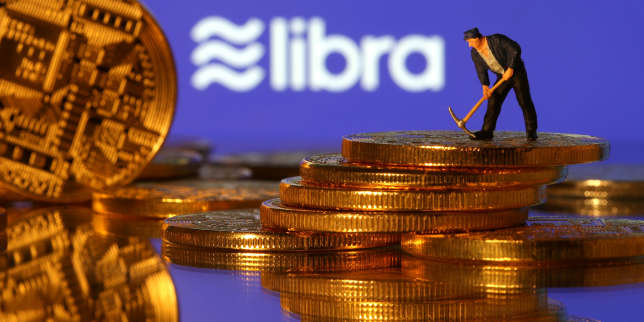 FILE PHOTO: A small toy figure stands on representations of virtual currency in front of the Libra logo in this illustration picture, June 21, 2019. REUTERS/Dado Ruvic/Illustration/File Photo