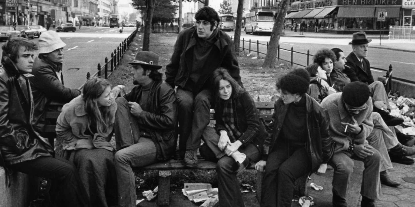 The gang, including Al Pacino and Kitty Winn, sit around on a bench in a scene from the film 'The Panic In Needle Park', 1971. (Photo by 20th Century-Fox/Getty Images) Archive Photos / Getty Images