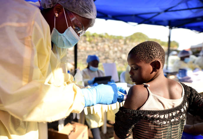 A Congolese health worker administers the experimental Ebola vaccine to a child at the Himbi Health Center in Goma, Democratic Republic of Congo, on July 17, 2019.