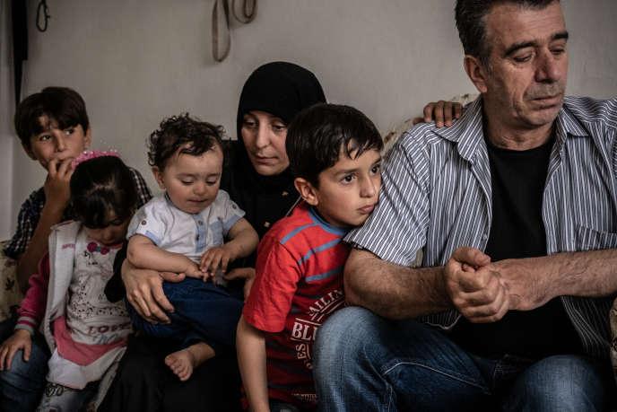 Musa, 43 ans, son épouse Murfet et leurs enfants, à Ankara, le 12 août. Photo fournie par le Programme alimentaire mondial.