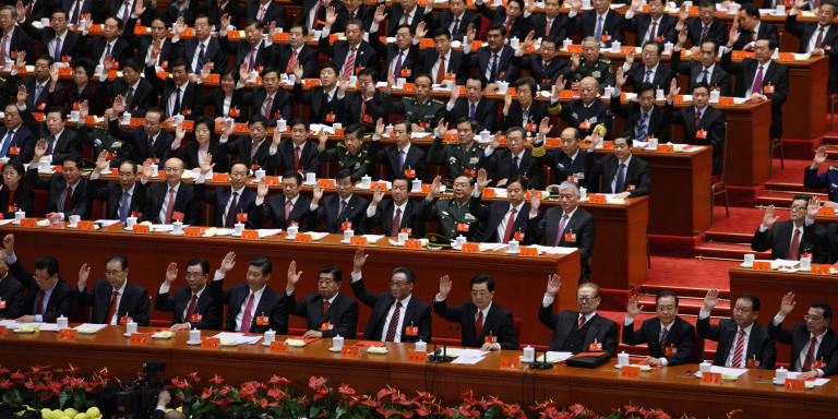 Xi Jinping, China's vice president, front row fourth left, Hu Jintao, China's president, front row fifth right, Jiang Zemin, former president, front row fourth right, Wen Jiabao, China's premier, front row third right, and Li Keqiang, vice premier, front row right, attend the closing session of the 18th National Congress of the Communist Party of China at the Great Hall of the People in Beijing, China, on Wednesday, Nov. 14, 2012. Xi and Li were reappointed to the Chinese Communist Party's Central Committee, positioning them to take over the top two posts in the world's second-biggest economy. Photographer: Tomohiro Ohsumi/Bloomberg via Getty Images