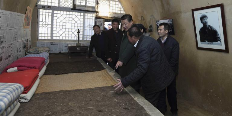 (150216) -- XI'AN, Feb. 16, 2015 (Xinhua) -- Chinese President and General Secretary of the Communist Party of China Central Committee Xi Jinping (3rd L), also chairman of the Central Military Commission, visits the cave dwelling he lived in during his teenage when he came to Liangjiahe Village as part of a campaign launched by Chairman Mao Zedong that asked urban youth to experience rural labor life, in Wen'anyi Township of Yanchuan County, Yan'an, northwest China's Shaanxi Province, Feb. 13, 2015. Xi made a tour in Shaanxi on Feb. 13 - 16, and extended festival greetings to locals and people across the nation ahead of the Spring Festival, which falls on Feb. 19.  (Xinhua/Lan Hongguang) (hdt)
