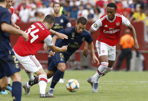 Jul 23, 2019; Landover, MD, USA; Real Madrid forward Eden Hazard (50) dribbles the ball as Arsenal midfielder Granit Xhaka (34) defends in the first half of a match in the International Champions Cup soccer series at FedEx Field. Mandatory Credit: Geoff Burke-USA TODAY Sports