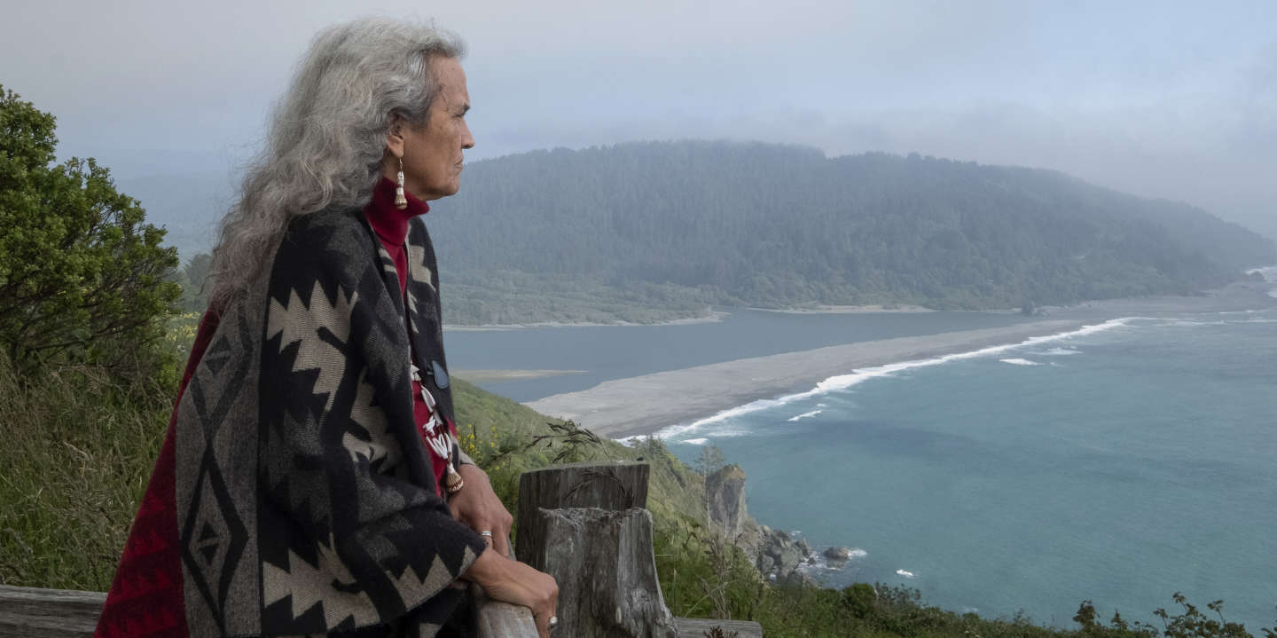 """Judge Abby Abinanti looks over at the mouth of the Klamath River. The river is a fundamental part of Yurok tradition and culture.  Abinanti, who became the first Native American woman admitted to the State Bar of California in 1974, created the Wellness Court, a part of the tribal court, which offers a healing path for nonviolent offenders struggling with substance abuse. In 2018, a Family Wellness Court was also created for parents who are struggling to care for their children as a result of substance abuse. """"This court is very different from others in its approach,"""" Abinanti said. """"There's not just one way to do things. Our practices are derived from our traditional value systems, our village values, which involve the community."""