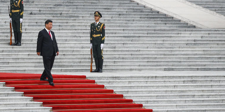 Chinese President Xi Jinping walks by members of an honor guard as he arrives for a welcome ceremony for visiting Abu Dhabi's Crown Prince, Sheikh Mohammed bin Zayed Al Nahyan, at the Great Hall of the People in Beijing, Monday, July 22, 2019. (AP Photo/Andy Wong)