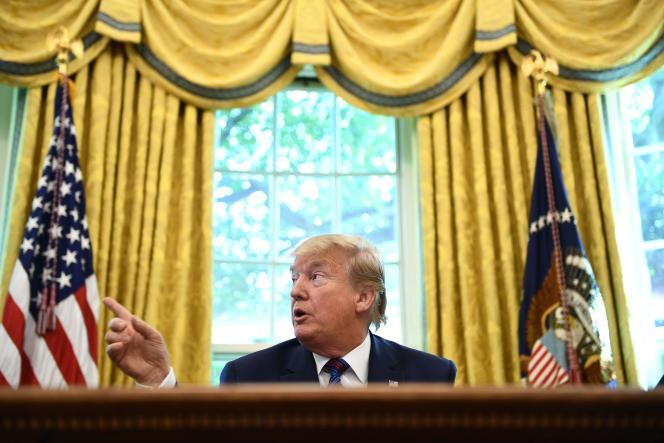 Le président des Etats-Unis, Donald Trump, s'adresse aux médias dans le bureau ovale de la Maison Blanche à Washington, le 26 juillet 2019.