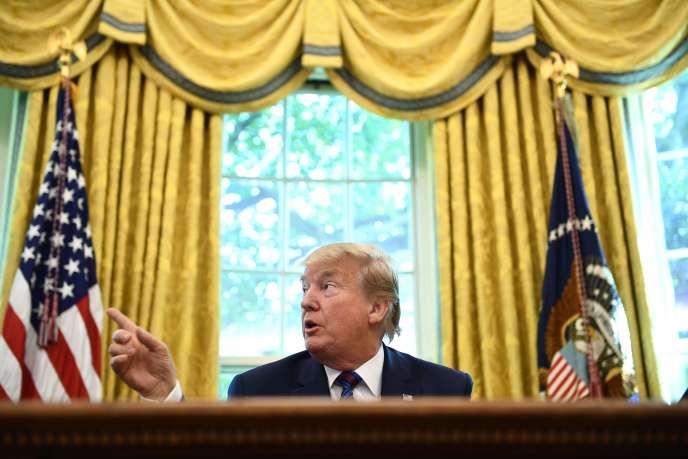 Le président américain, Donald Trump, dans le bureau Ovale de la Maison Blanche à Washington, le 26 juillet.