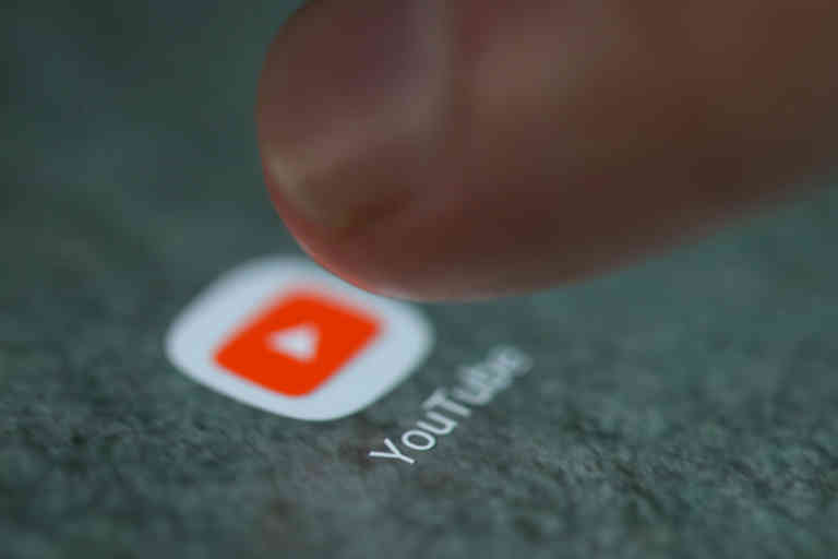 The YouTube app logo is seen on a smartphone in this picture illustration taken September 15, 2017. REUTERS/Dado Ruvic/Illustration - RC1F9FACE150