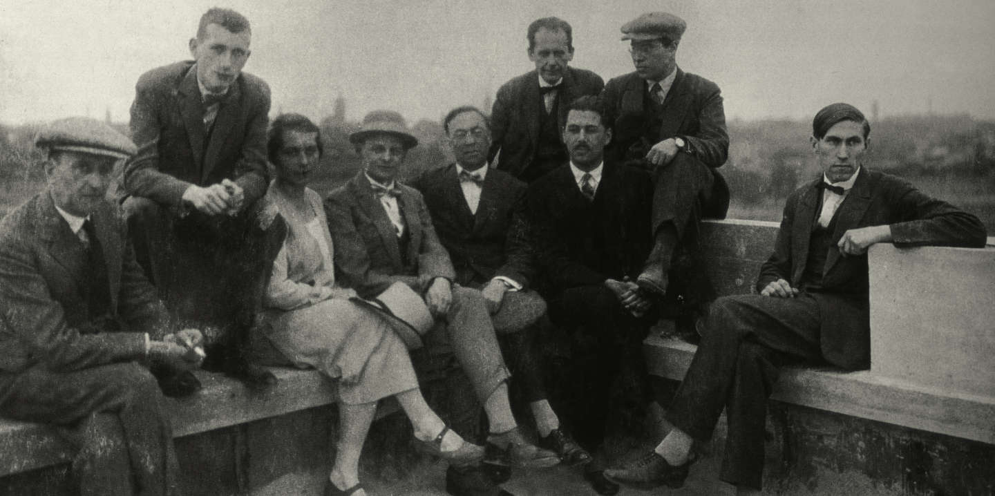 Bayer, Herbert, 1900–1985, Austrian and American graphic designer, painter, photographer, sculptor and architect, who was widely recognized as the last living member of the Bauhaus and was instrumental in the development of the Atlantic Richfield Company's corporate art collection until his death in 1985.  Group photo of the Bauhausmeister on the roof of the Bauhaus building in Dessau: From left to right: Josef Albers, Marcel Beuer, Gunta Stölzl, Oskar Schlemmer, Wassily Kandinsky, Walter Gropius, Herbert Bayer, Lázló Moholy-Nagy, Hinnerk Scheper.  Photo, Walter Gropius with self-timer, Dessau 1926.
