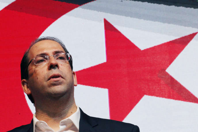 Le premier ministre tunisien, Youssef Chahed, annonce sa candidature à l'élection présidentielle lors d'un meeting à Tunis, le 8août 2019.
