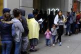 Le 31 janvier 2019, des immigrés attendent leur tour pour entrer dans le bureau d'immigration américain à San Francisco.