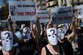 Des manifestants demandent « la vérité» lors d'une marche en hommage aux victimes des attentats de Barcelone, le 17 août 2019.