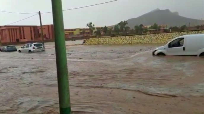 Flood waters sweep through a town in the Ighrem region of Morocco, Wednesday Aug. 28, 2019, as heavy rain continues to fall.  At least seven people watching a local soccer match in the southern Moroccan village of Tizert have died in a flash flood that swept across the football field, Wednesday, the official MAP news agency said.  (Abdallah Darif via AP)