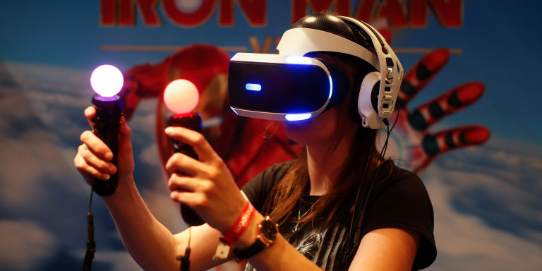 A gamer plays on a Playstation VR with virtual reality goggles and two controllers that look like regular bulbs during the first day of Europe's leading digital games fair Gamescom, which showcases the latest trends of the computer gaming scene in Cologne, Germany, August 21, 2019. REUTERS/Wolfgang Rattay - RC14DF7A0E40