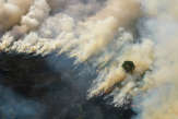 Feux en Indonésie: un nuage de fumée toxique gagne Singapour et la Malaisie