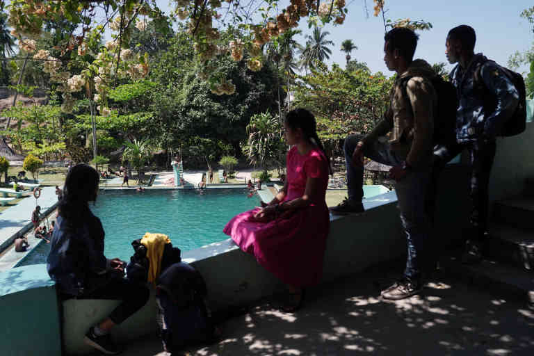 Local youths attend a spring-fed swimming pool, built during the Portuguese era, in Baucau, Timor-Leste, on Sunday, Aug, 25, 2019. Twenty years on from a referendum that brought independence from Indonesia after a brutal quarter-century conflict killed an estimated 100,000 people, Timor-Lestes birthing pains are evident everywhere. With almost half its 1.2 million people living in poverty, the aging war heroes still in charge are now betting big on a risky energy project that could draw one of the worlds youngest nations into a wider geopolitical tussle between the West and China. Photographer: Dimas Ardian/Bloomberg via Getty Images
