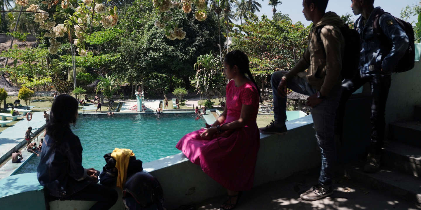 Local youths attend a spring-fed swimming pool, built during the Portuguese era, in Baucau, Timor-Leste, on Sunday, Aug, 25, 2019. Twenty years onfrom a referendum that brought independence from Indonesia after a brutal quarter-century conflict killed an estimated 100,000 people, Timor-Lestes birthing pains are evident everywhere. With almost half its 1.2 million people living in poverty, the aging war heroes still in charge are now betting big on a risky energy project that could draw one of theworlds youngest nationsinto a wider geopolitical tussle between the West and China. Photographer: Dimas Ardian/Bloomberg via Getty Images