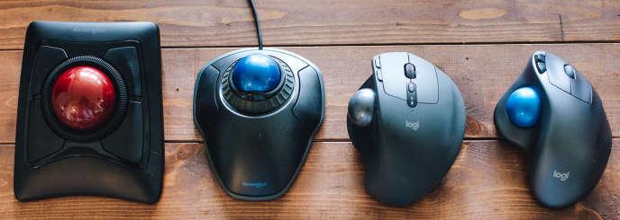 De gauche à droite : Expert Mouse de Kensington, Orbit avec molette de défilement de Kensington, MX Ergo de Logitech et M570 de Logitech.