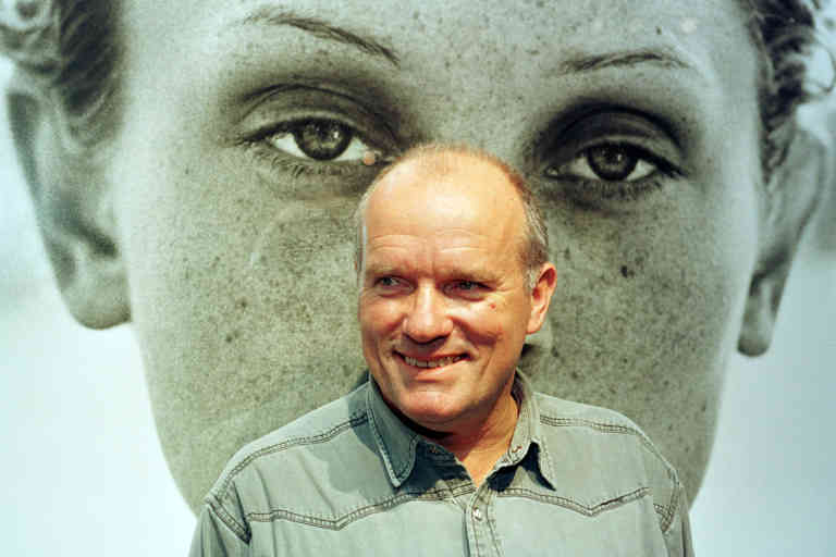 German photographer Peter Lindbergh stands in front of his portrait of American model Berri Smither during a press presentation of his exhibition