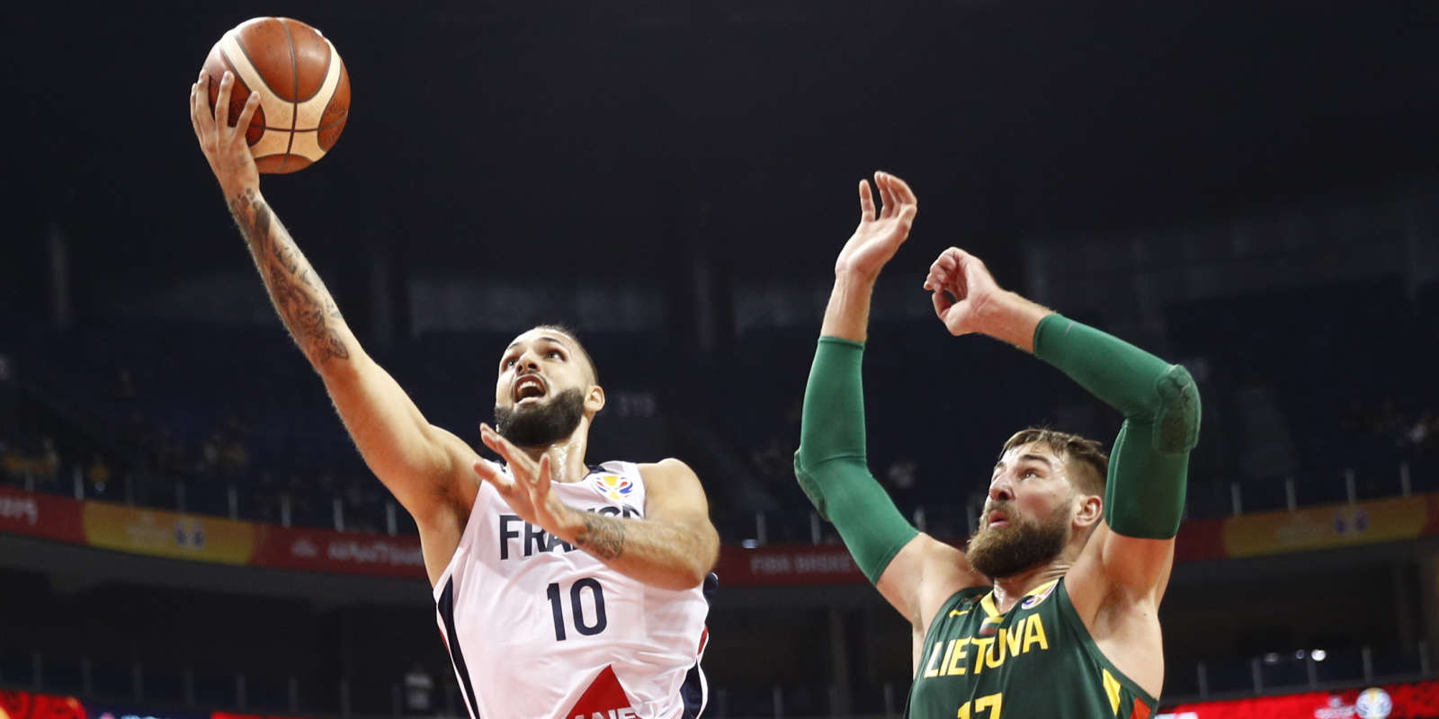 Basketball - FIBA World Cup - Second Round - Group L - France v Lithuania - Gymnasium of Youth Olympic Games Sport Park, Nanjing, China - September 7, 2019 France's Evan Fournier in action with Lithuania's Jonas Valanciunas REUTERS/Edgar Su