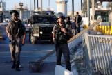 Des policiers israéliens montent la garde au checkpoint de Qalandiya, en Cisjordanie, mercredi18septembre.