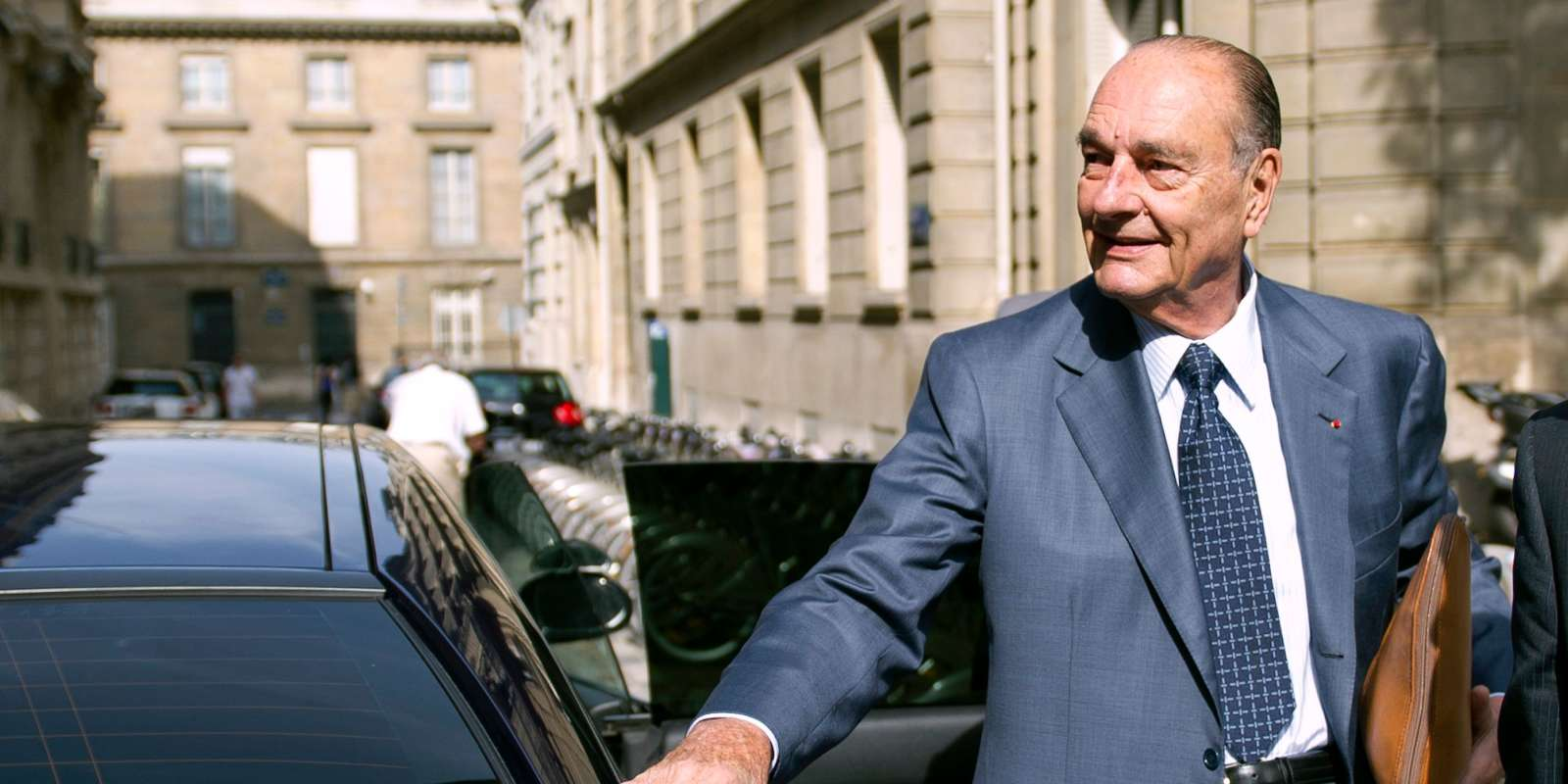(FILES) In this file photo taken on September 01, 2011, French former president Jacques Chirac arrives at his office, in Paris, five days ahead of the start of his trial for corruption relating to his time as Paris mayor in the 1990s. Former French President Jacques Chirac has died at the age of 86, it was announced on September 26, 2019. / AFP / BERTRAND LANGLOIS