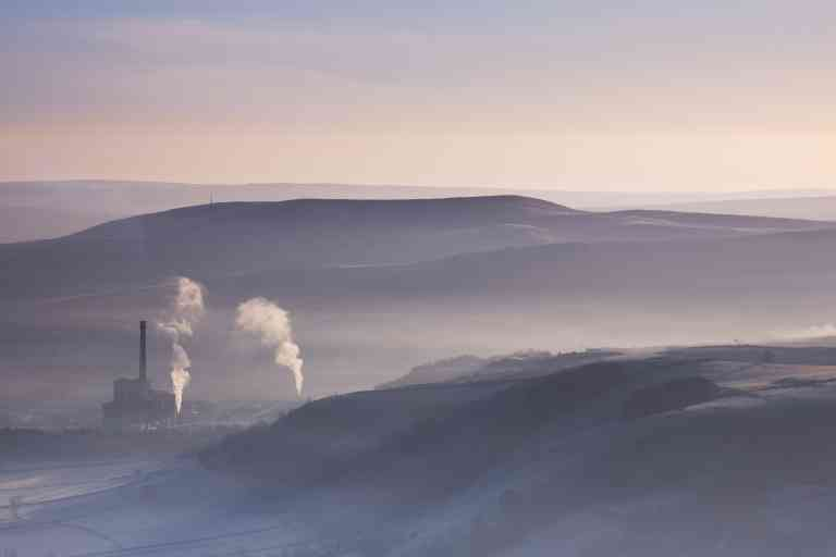 England, Peak District, Hope Valley. Hope Valley Cement Works shrouded in mist in the Peak District National Park.