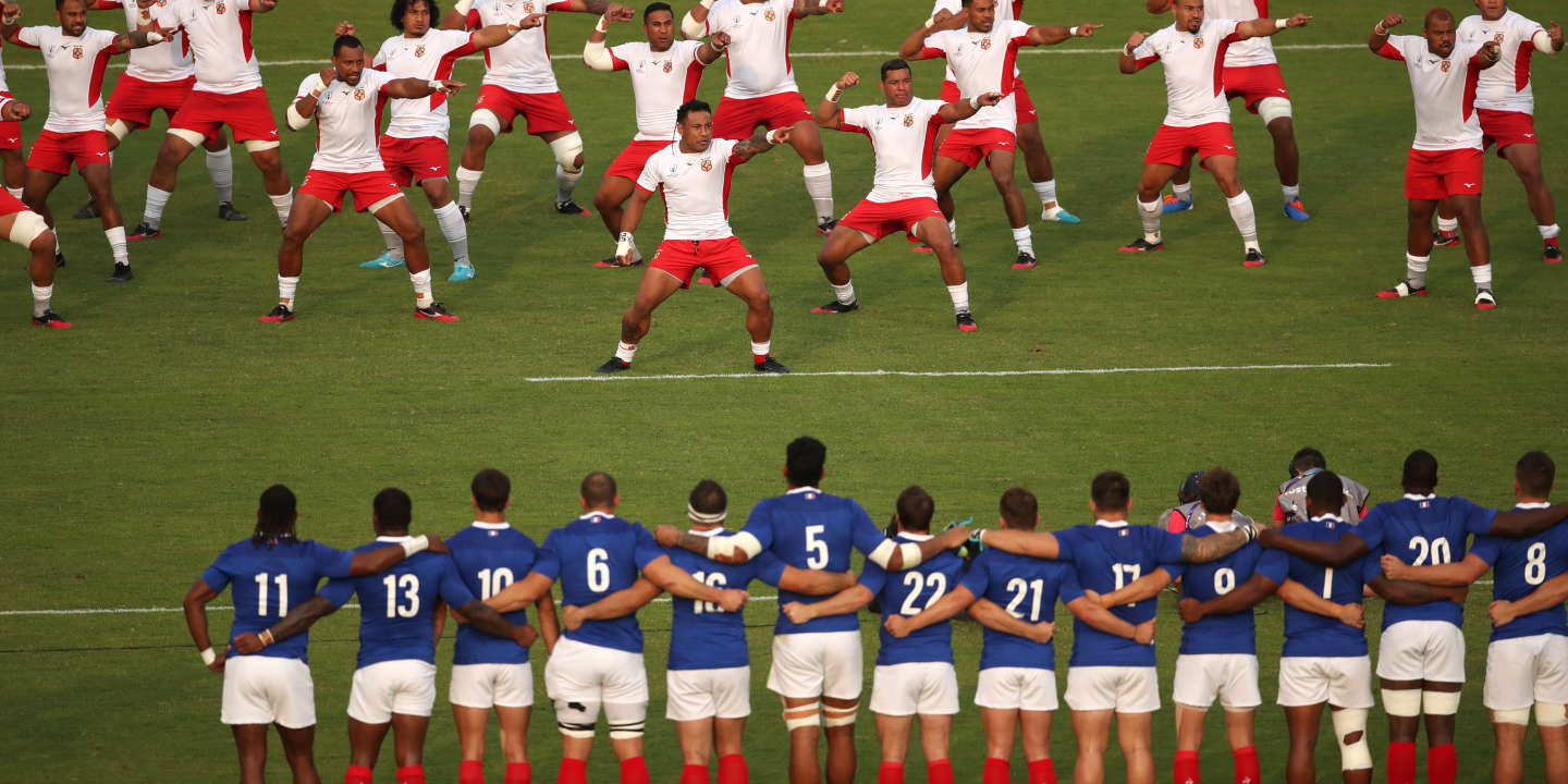 Rugby Union - Rugby World Cup 2019 - Pool C - France v Tonga - Kumamoto Stadium, Kumamoto, Japan - October 6, 2019 Tonga players perform the Sipi Tau dance in front of France players before the match REUTERS/Peter Cziborra
