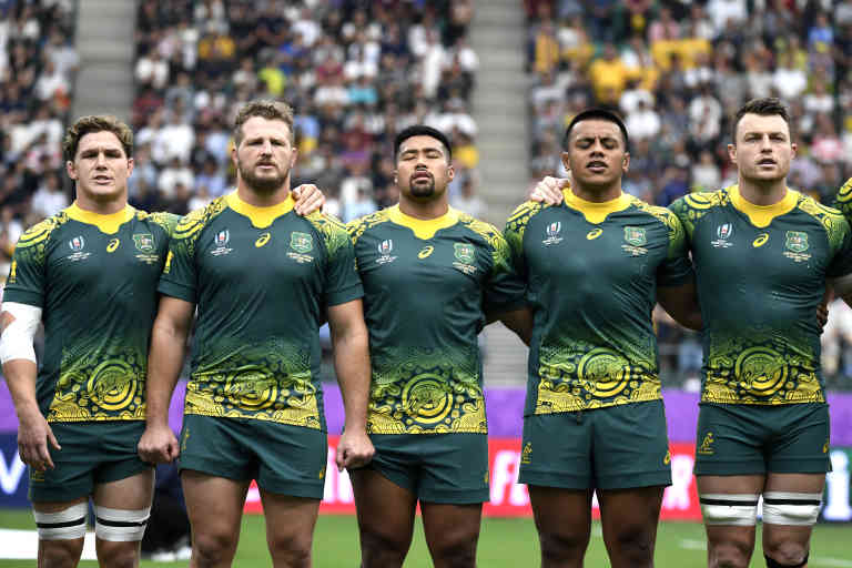 Australia's players sing their national anthem during the Japan 2019 Rugby World Cup Pool D match between Australia and Uruguay at the Oita Stadium in Oita on October 5, 2019. (Photo by CHRISTOPHE SIMON / AFP)