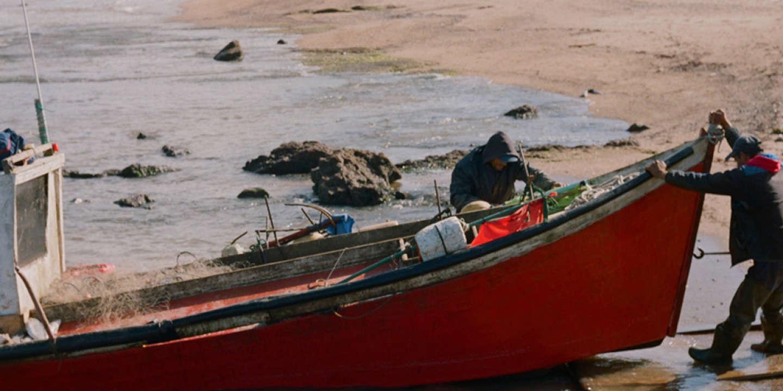 A fisherman takes his boat of the water in JosÈ Ignacio beach , Uruguay, Saturday, Sept.29, 2019.  Photo: Matilde Campodonico